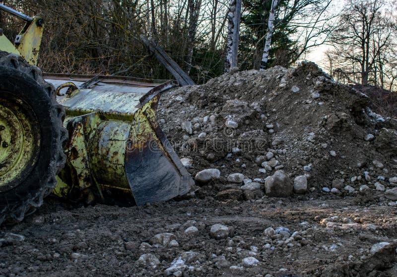 Grävskopapåfyllningar vaggar fotografering för bildbyråer