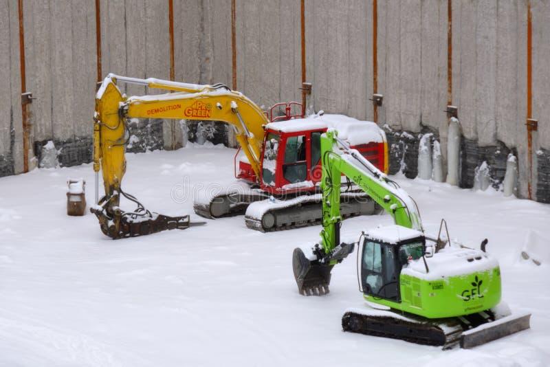 Grävskopor på en konstruktionsplats arkivfoto