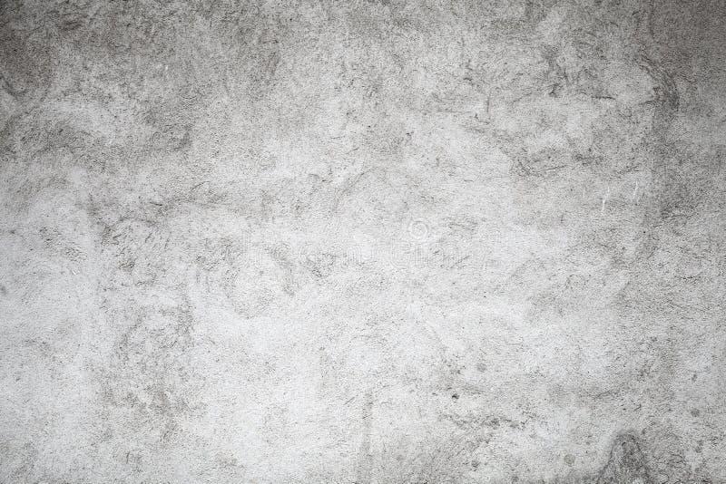 Grå betongvägg, grungy plan bakgrundstextur royaltyfria foton