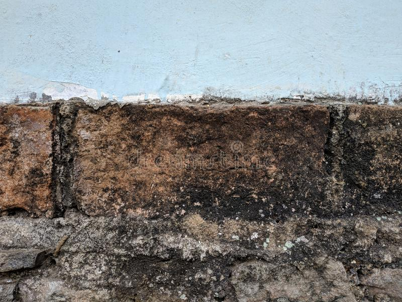 Grå betongväggtextur och tegelstenvägg arkivbilder