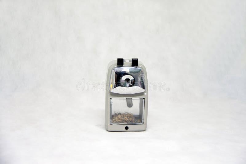 Grå färg av vässaren som isoleras på vit tygbakgrund arkivfoton