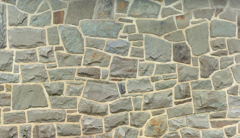 Grå färger för fieldstone för stenvägg vaggar bakgrund royaltyfri fotografi