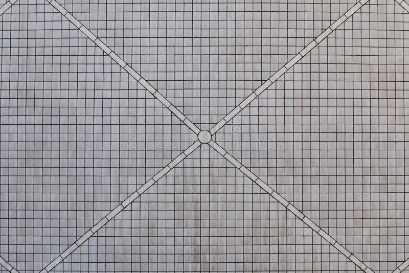 Grå keramisk tegelstentegelplattavägg royaltyfria foton