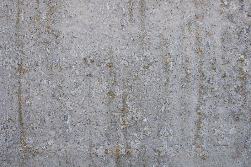 Grå konkret texturbakgrund sprickor arkivfoto