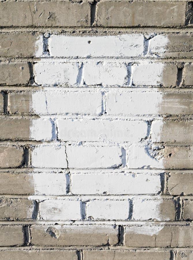 grå målad vit rektangelvägg för tegelsten arkivbild