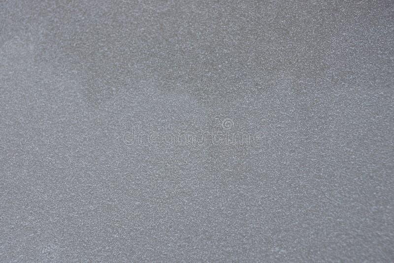 Grå mörk bakgrund av ett fragment av en betongvägg royaltyfria bilder