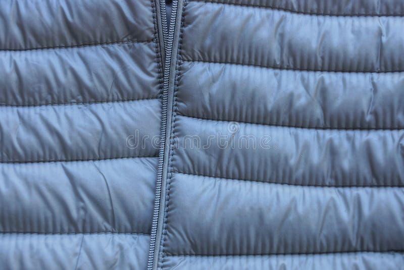 Grå plast- textur av ett stycke av kläder fotografering för bildbyråer