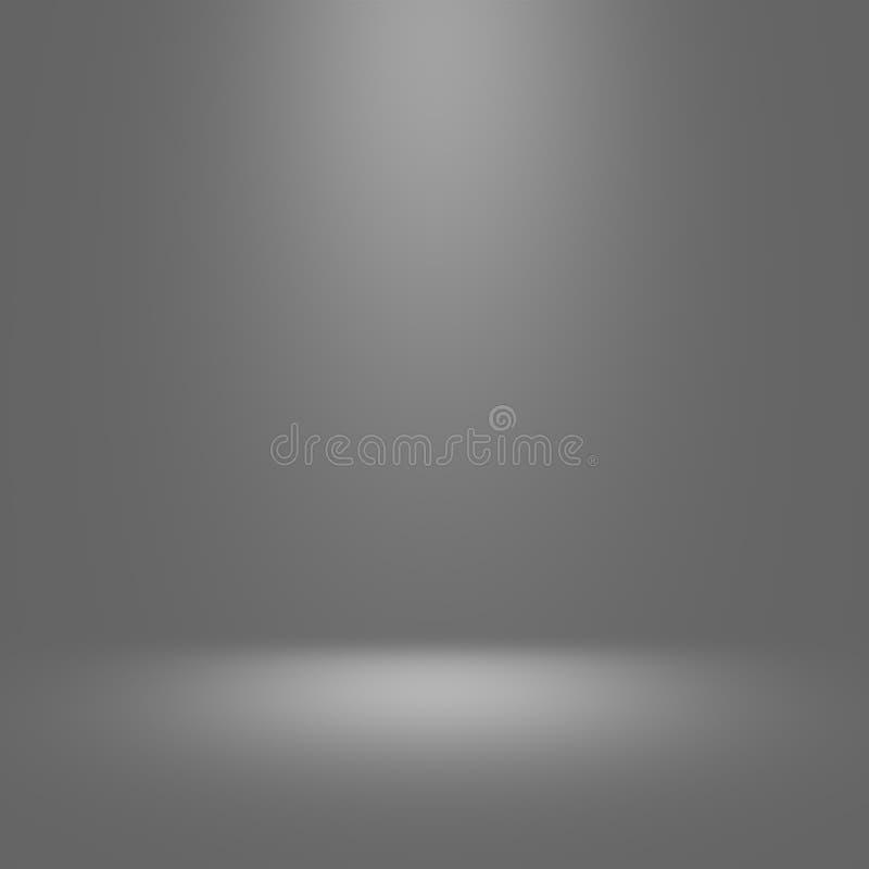 Grå studiobakgrund med strålkastaren arkivfoton