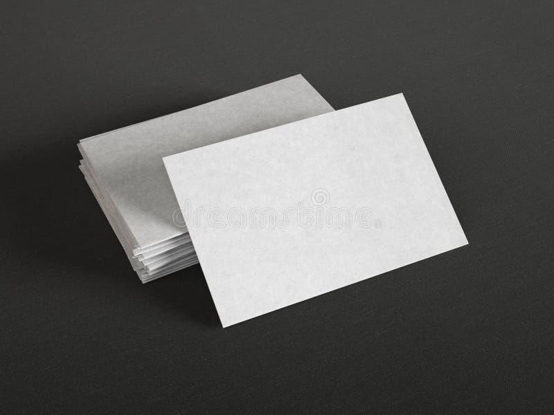 Gråa affärskort på mörk bakgrund royaltyfria foton