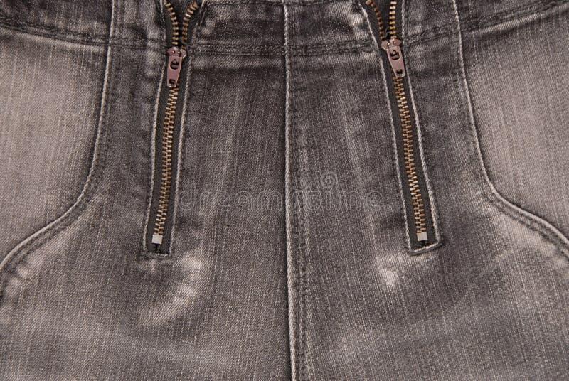Gråa grov bomullstvillbakgrunder, slut upp av jeans, trendig byxa arkivbilder