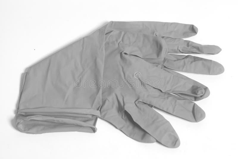Gråa latexhandskar arkivfoto