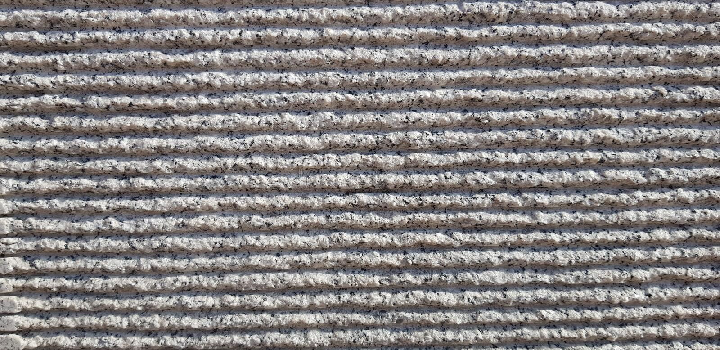 Gråa stenar med randig texturbakgrund arkivbild