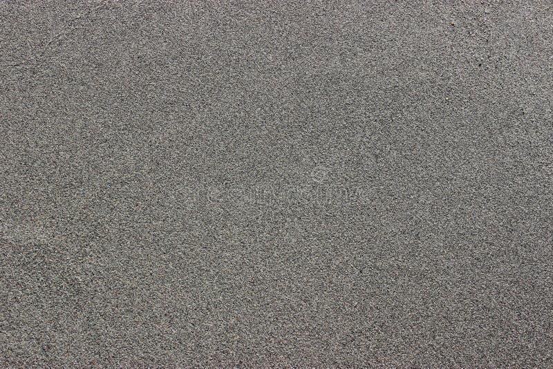 Gråna sanden arkivfoto