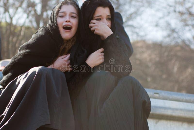 Gråta kvinnor på Jesus. royaltyfri foto