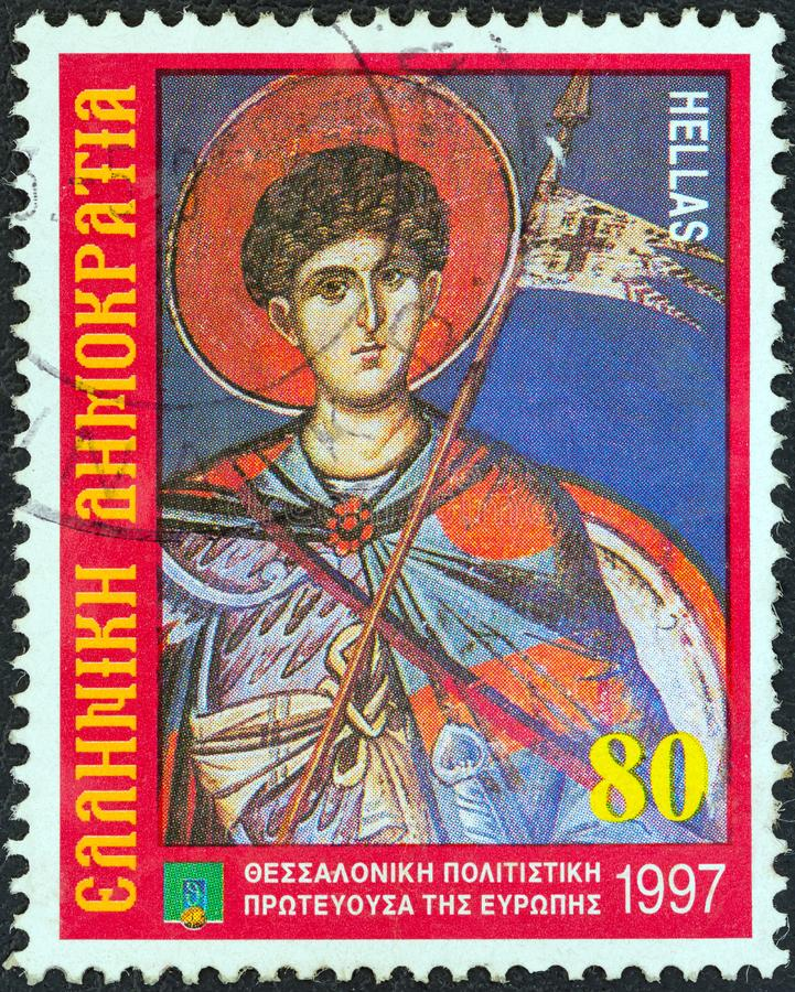 GRÉCIA - CERCA DE 1997: Um selo impresso no fresco de Dimitrios do santo padroeiro das mostras de Grécia, Agios Nikolaos Orphanos fotos de stock