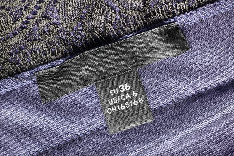 Größenkleidungsaufkleber lizenzfreie stockfotografie