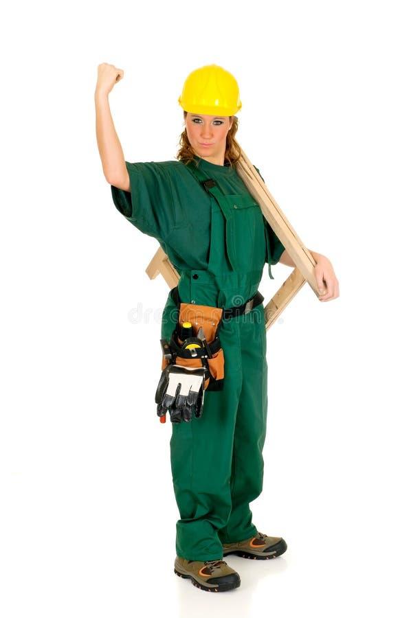 grön arbetare för konstruktion arkivfoto