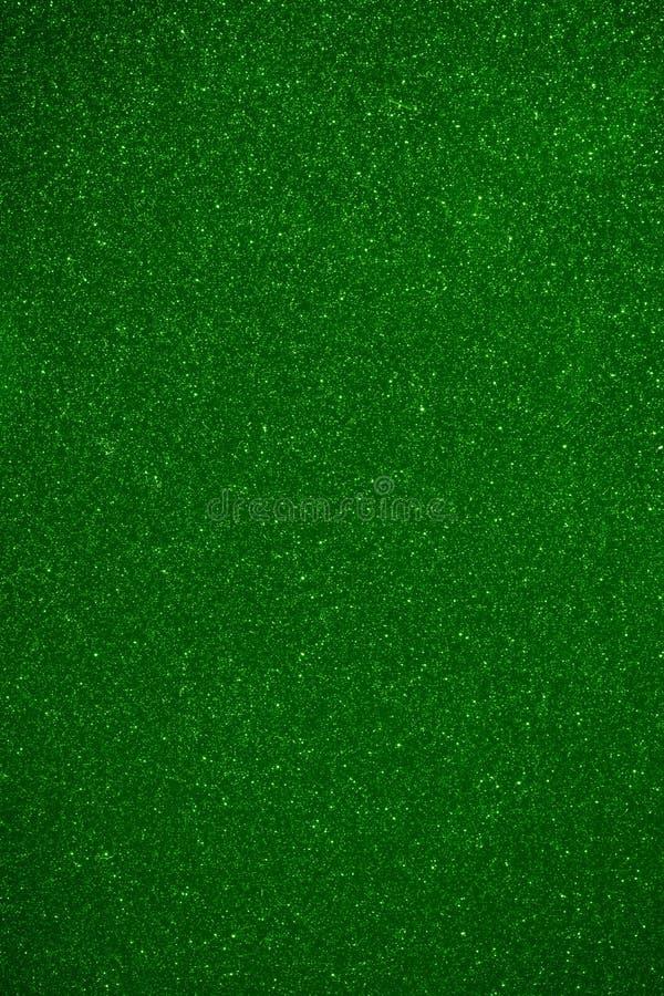 Grön bakgrund för skinande partiklar royaltyfri bild