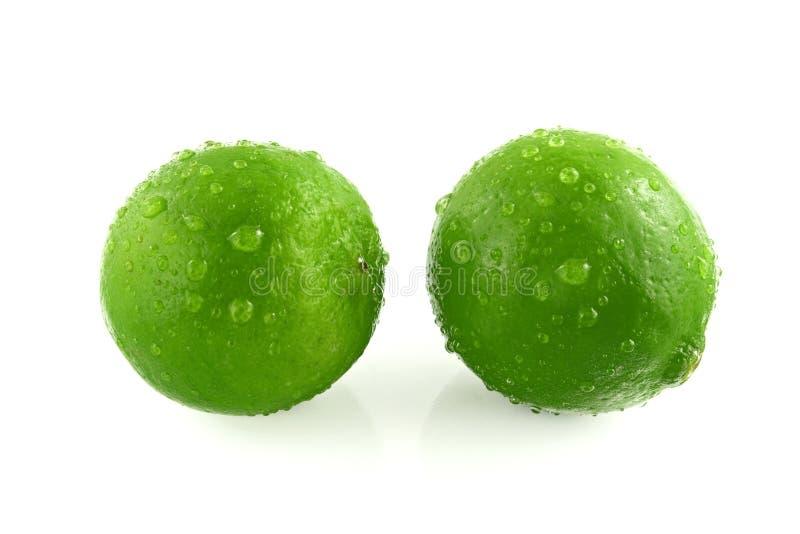 grön citron för liten droppe arkivbilder