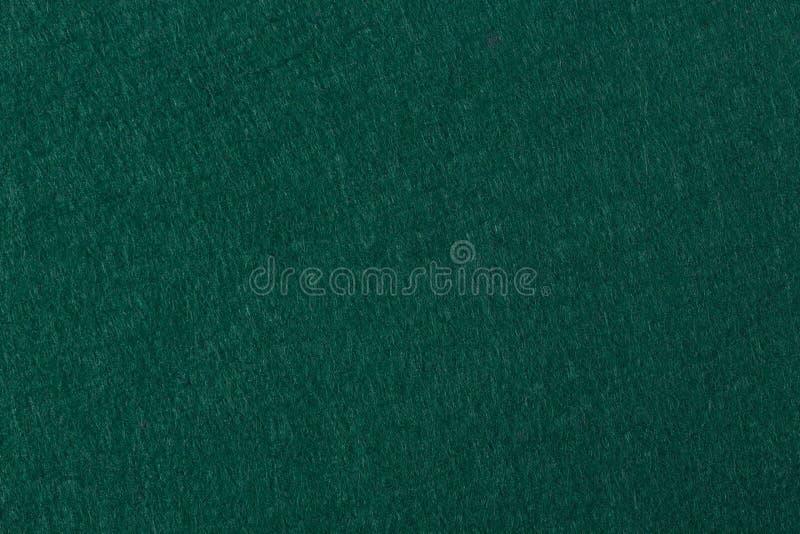 Grön filtbakgrund Användbart för pokertabell eller bränning för pöltabell arkivfoto
