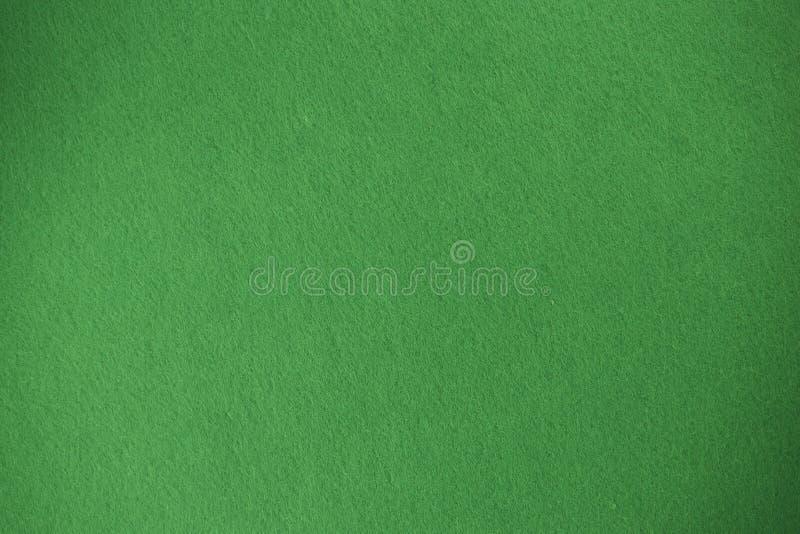 Grön filttexturbakgrund det isolerade vävde tyget royaltyfri bild