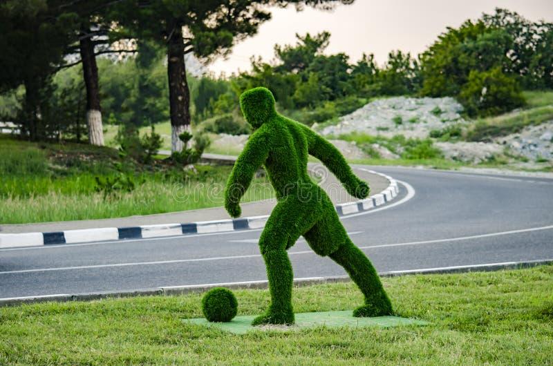 Grön fotbollsspelare royaltyfri bild