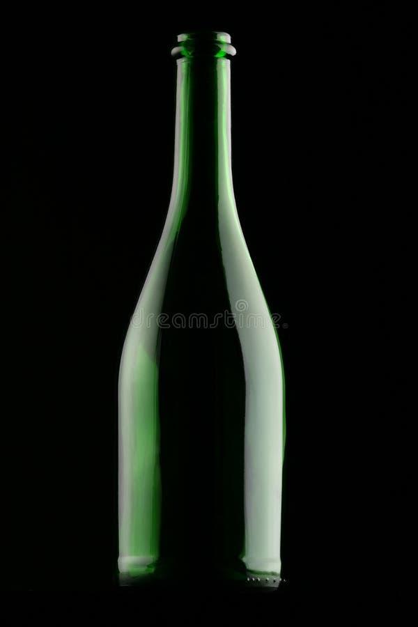 Grön glasflaska arkivbild