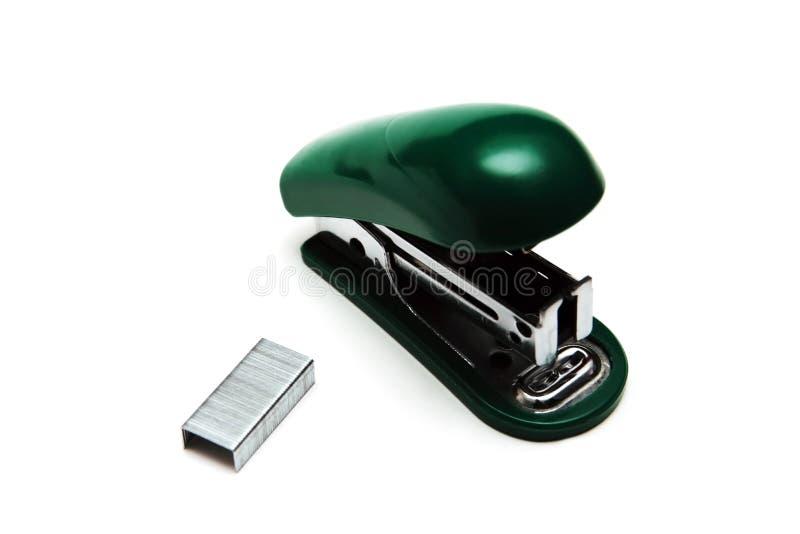grön häftapparat fotografering för bildbyråer