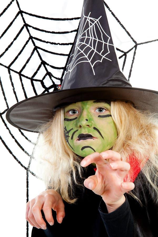 grön halloween läskig spiderwebhäxa arkivbild