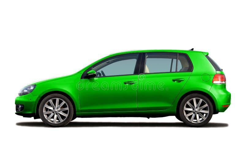 grön hatchback royaltyfri fotografi