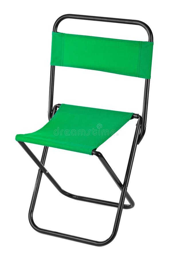 Grön hopfällbar stol arkivfoton