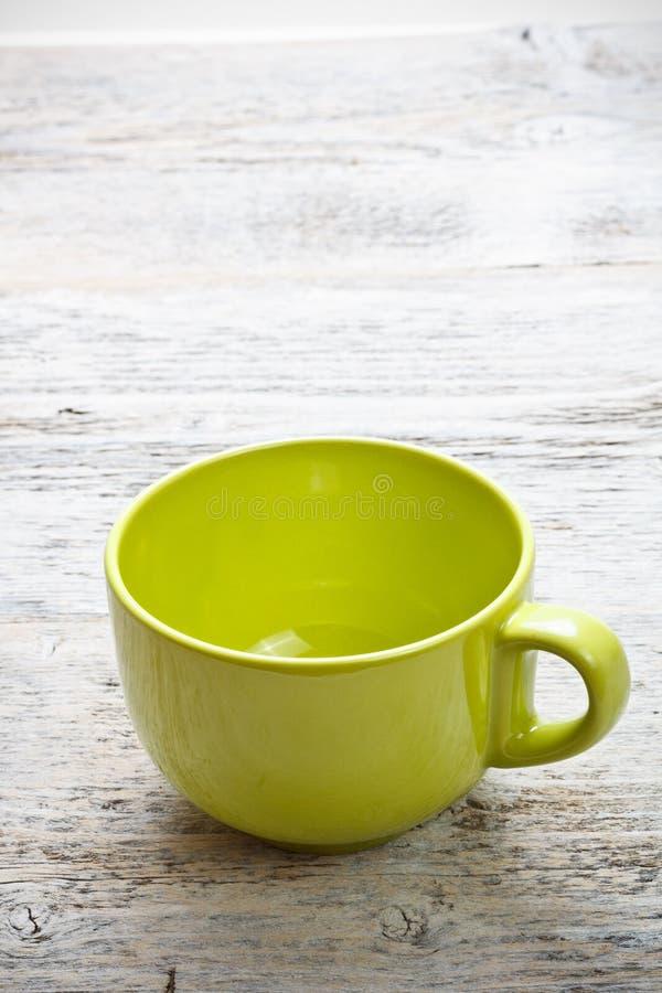 Download Grön kaffekopp fotografering för bildbyråer. Bild av studio - 27284495