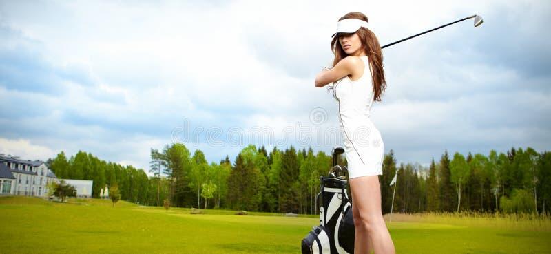 grön leka kvinna för golf arkivbilder