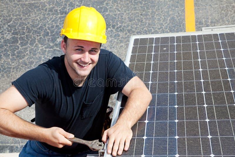 grön lycklig jobbarbetare royaltyfria foton
