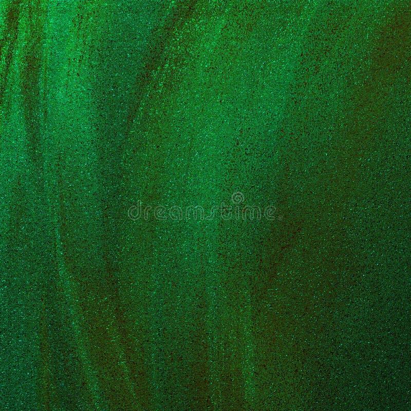 Grön metallisk sand texturerade abstrakt bakgrund Tonat borsteslaglängdkonstverk Glitter spridde på grungy grov yttersida royaltyfria foton