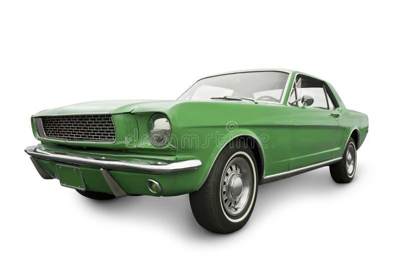 Grön muskelbil från 1965 arkivfoto