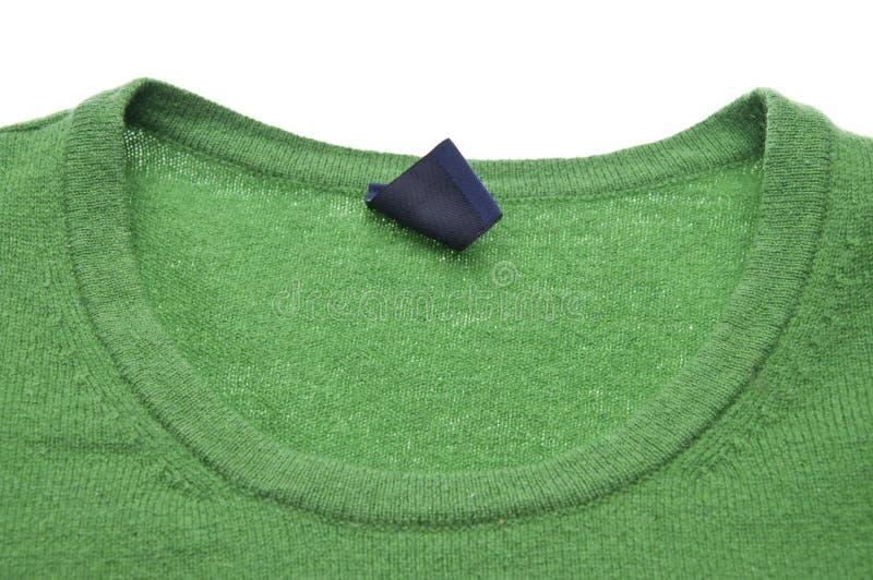grön neclkinetröja royaltyfria bilder