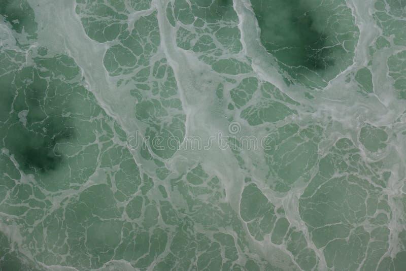 Grön och blå yttersida av havet arkivbild