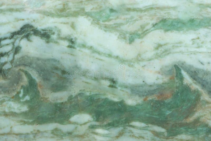 Grön och vit genomskinlig gemstoneyttersida Grön textur för jade royaltyfria foton