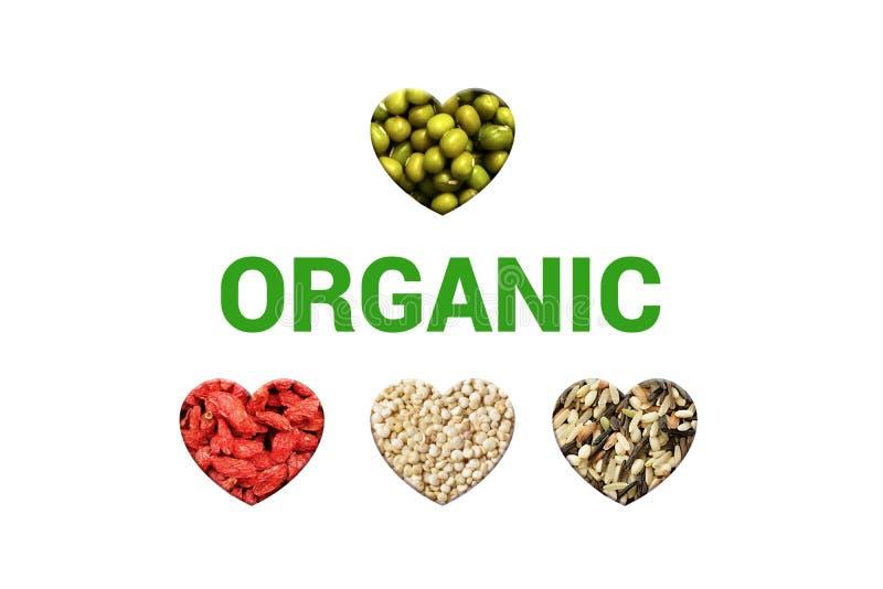 Grön organisk text på vita bakgrund och hjärtor med mung för grönt gram bönor, vita quinoakorn, torkad goji b arkivfoton