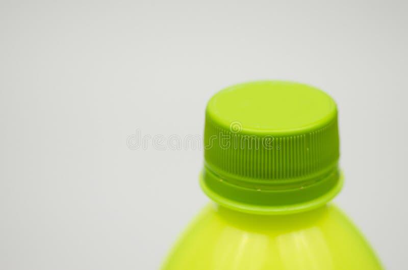 Grön plast- kapsyl royaltyfri bild