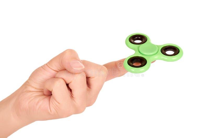 Grön rastlös människaspinnare i handen som isoleras på vit bakgrund fotografering för bildbyråer