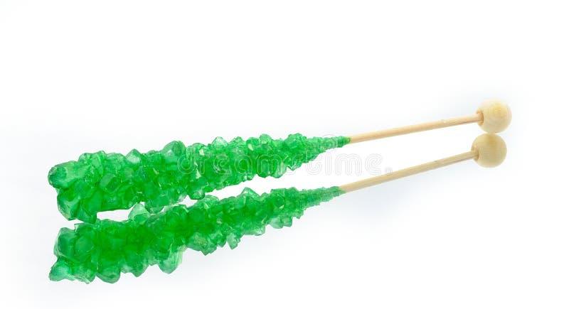 Grön rockgodis med sticken arkivfoto