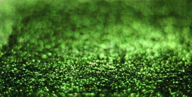 Grön skinande estetisk bakgrund royaltyfria bilder
