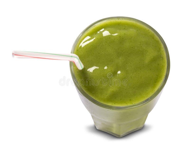 Grön smoothie i ett exponeringsglas med sugrör som isoleras på en vit backgr royaltyfria foton
