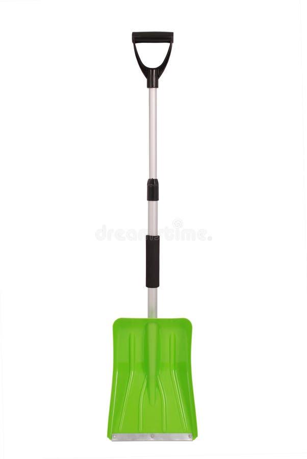 Grön snöskyffel royaltyfria foton