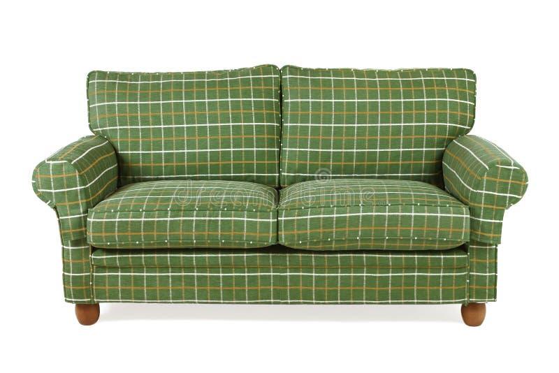 grön sofa arkivbild