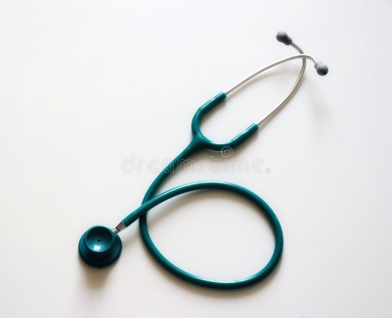 grön stetoscope arkivbilder