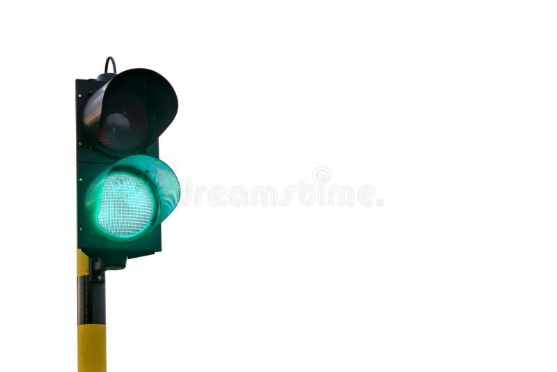 Grön trafikljus som isoleras på vit bakgrund arkivbilder