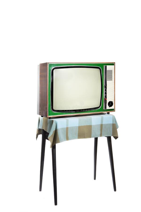 Grön TV för tappning, på tabellen royaltyfri fotografi